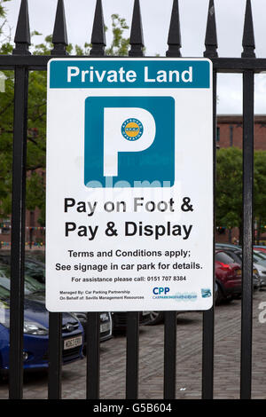 Private Land  Pay on Foot  Pay and display car parking in Liverpool, Merseyside, UK - Stock Photo
