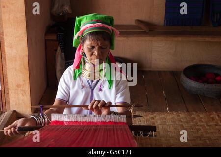 Padaung (long neck) women weaving, Lake Inle, Myanmar - Stock Photo