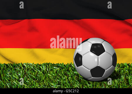 3D rendered soccer ball in grass field with Germany flag as Background - Stock Photo