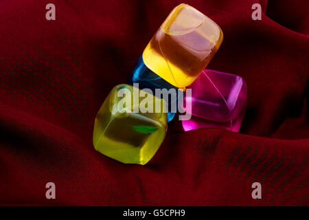 colorful little cubes on a dark background - Stock Photo