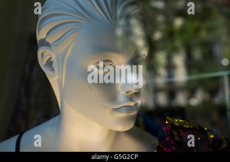 Female mannequin head with soft expression and blurred foreground. - Stock Photo