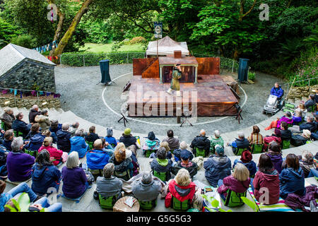 The audience at the start of Miracle Theatre's Performance of Life's a Dream at the Trebah Gardens amphitheatre - Stock Photo