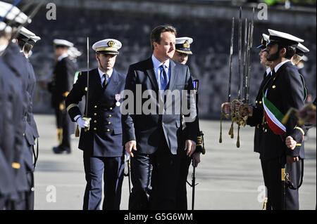 Prime Minister David Cameron views Naval cadets during a passing out parade, at the Britannia Royal Naval College in Dartmouth, where he took the salute.