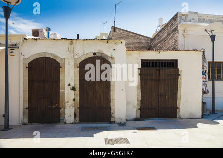 Wooden doors in old brick house in the city of Limassol, Cyprus - Stock Photo