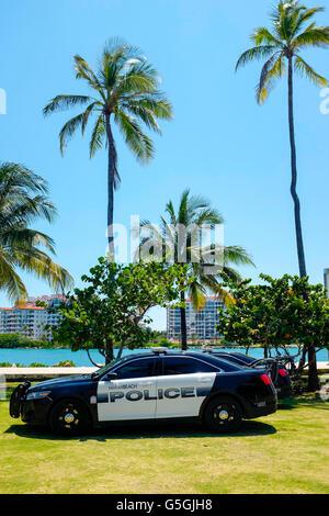 Police cars on South Pointe Park, South Beach Miami Florida USA. - Stock Photo