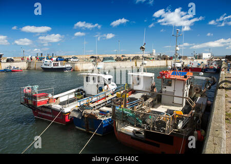 UK, England Northumberland, Seahouses Harbour, fishing and day trip craft at quayside - Stock Photo