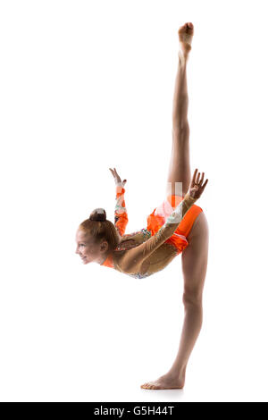 Beautiful happy gymnast athlete teenage girl wearing dancer colorful leotard working out, dancing, posing, doing - Stock Photo