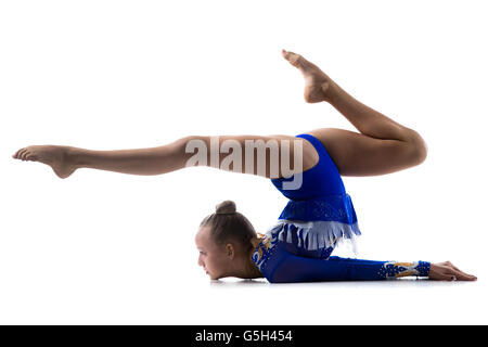 Attractive gymnast athlete teenage girl wearing dancer blue leotard working out, dancing, posing, doing art gymnastics - Stock Photo