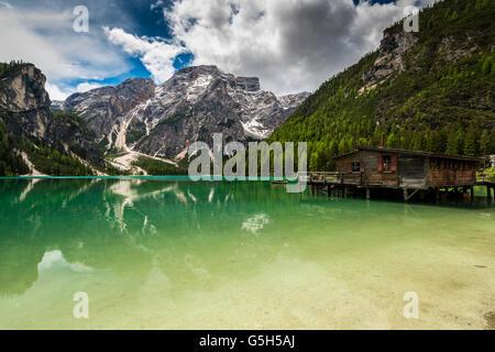 Lake Braies or Pragser Wildsee with Croda del Becco or Seekofel mountain behind, South Tyrol, Italy - Stock Photo