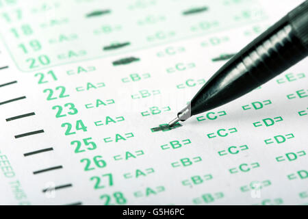 An answer sheet or optical mark recognition sheet with a mechanical pencil. - Stock Photo