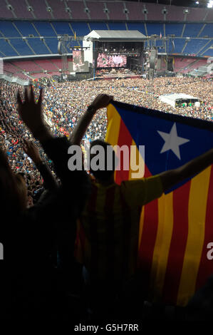 A bruce springsteen fan waves the Estelada flag, national flag of catalonia at the Bruce Springsteen concert at - Stock Photo