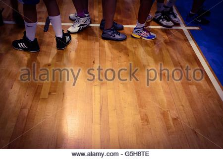 Basketball players on court - Stock Photo