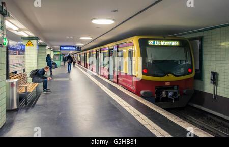 U-Bahn Station with train approaching, Berlin, Germany - Stock Photo