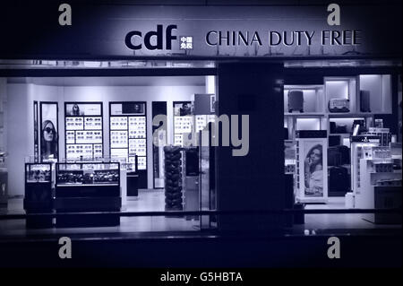Duty Free Store, Guanghzou Airport, China. Editorial use only. - Stock Photo