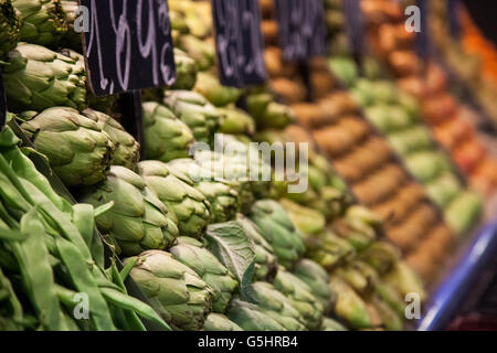Fruits and vegetables stall in La Boqueria, the most famous market in Barcelona. - Stock Photo