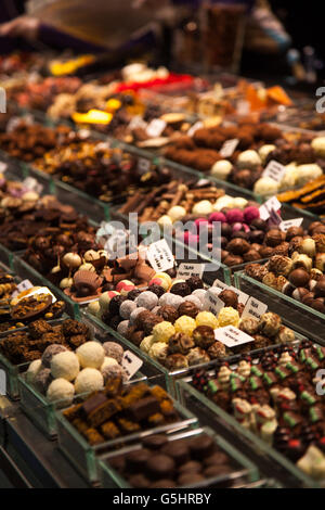 Various Nuts, almonds, sweets and dried fruits for sale at the market - Stock Photo