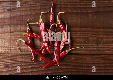 Dried Chili Still Life. Horizontal format on a rustic wood table with copy space. - Stock Photo