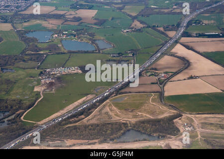Horizontal aerial view of a traffic jam on the southbound carriageway of the M25 in Essex. - Stock Photo
