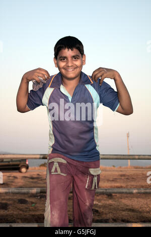 A small kid from an Indian village, in the outdoors. - Stock Photo