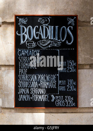 Vertical close up of a chalkboard pricelist for traditional Bocadillos in Majorca. - Stock Photo