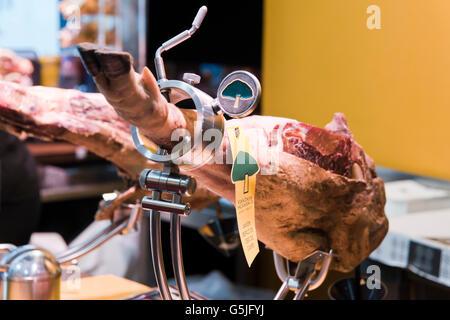 Horizontal close up of an Iberian ham in a jamonera in Majorca. - Stock Photo