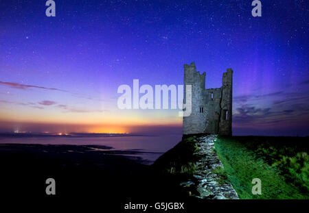 The Northern Lights Behind Lilburn Tower/Dunstanburgh Castle, Northumberland - Stock Photo