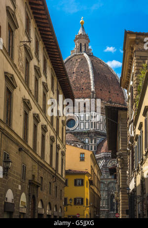 Street of Florence with Santa Maria del Fiore Cathedral, also called Duomo, in the back, Tuscany, Italy - Stock Photo