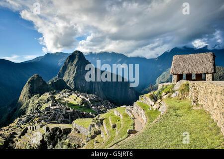 Guardhouse (right) and Machu Picchu ruins, Cusco, Peru - Stock Photo