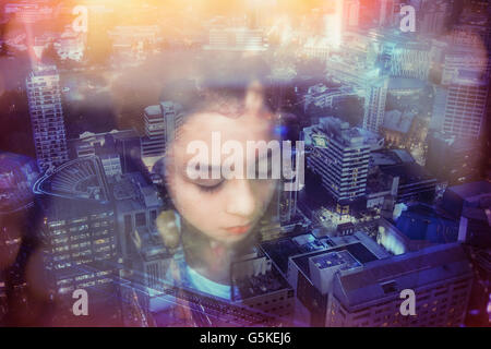 Face of mixed race girl over cityscape, Auckland, New Zealand - Stock Photo