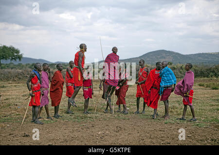 Group of Masai warriors doing a ceremonial dance in a Masai village, Kenya, Africa. - Stock Photo