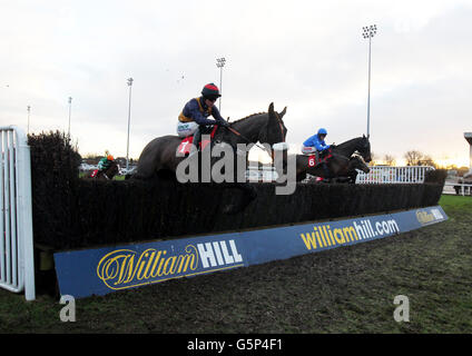 Mister Hyde (right) ridden by Jason Maguire jumps a hurdle on their way to winning the William Hill - No 1 Downloaded - Stock Photo