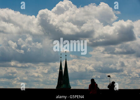 Nuremberg, Germany. 22nd June, 2016. Tourists take pictures before backdrop of clouds from the wall of Nuremberg - Stock Photo