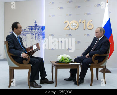 St.Petersburg. 17th June, 2016. Russian President Vladimir Putin (R) is interviewed by President of Xinhua News - Stock Photo