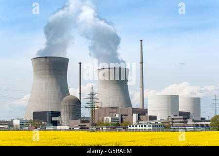 Nuclear power Energy concept - Nuclear power plant with yellow field and big blue clouds. Nuclear power plant in - Stock Photo