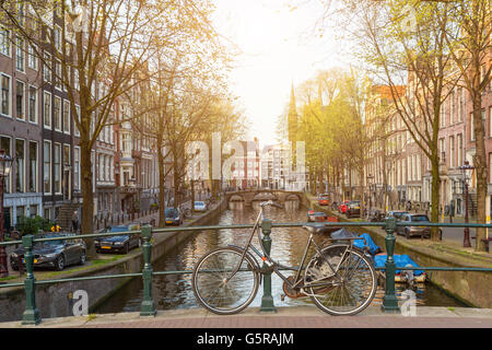 Bikes on the bridge in Amsterdam Netherlands - Stock Photo