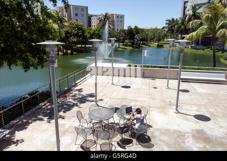 Miami Florida FIU International University campus student laptop studying - Stock Photo