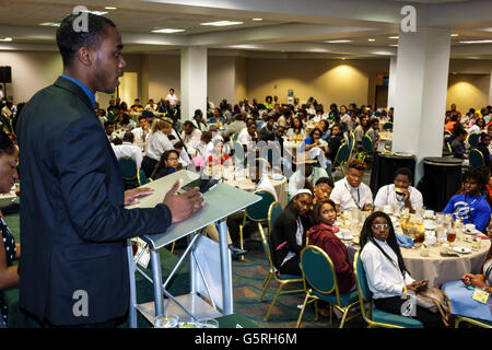 Miami Florida Hyatt hotel National Preventing Crime in the Black Community Conference Black teen boy speaking microphone - Stock Photo