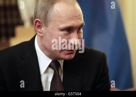Russian President Vladimir Putin talk during their meeting at the Presidential Palace in Athens, Friday, May 27, - Stock Photo