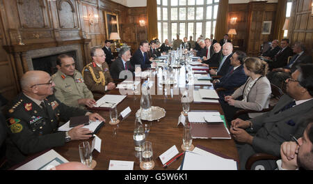 Prime minister David Cameron (5th left) hosts a trilateral meeting , with President Hamid Karzai of Afghanistan and President Asif Ali Zardari ( both seated either side of Foreign secretary Willaim Hague ) at Chequers, Buckinghamshire.