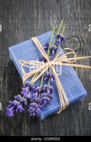 Lavender handmade artisan soap with fresh flowers on rustic wooden background - Stock Photo