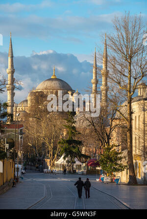 Looking down Kabasakal Cadsi past the Mousoleum of Mehmet III with the Blue Mosque  background, Sultanahmet, Istanbul, - Stock Photo