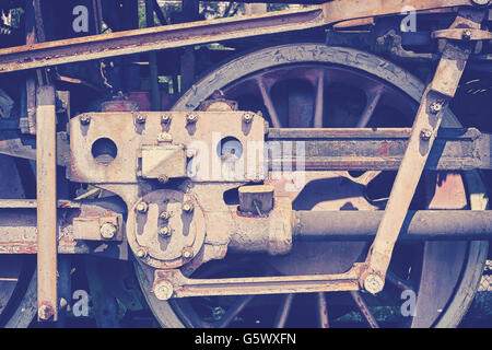Vintage toned old rusty steam locomotive wheel. - Stock Photo