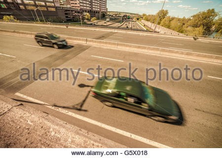 Automobiles on a highway. - Stock Photo