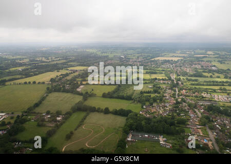 An aerial view of fields and houses on the approach to Gatwick airport, London - Stock Photo