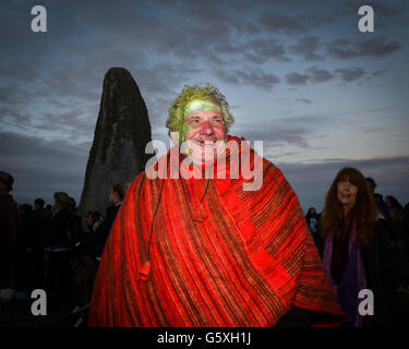 Revellers converge on Stonehenge to celebrate the Summer Solstice - Stock Photo