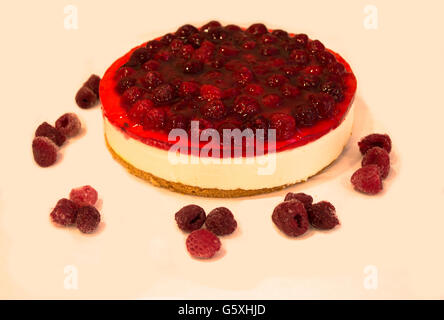 Raspberry Cheesecake Isolated on a White Background - Stock Photo