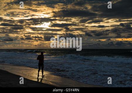 Man running in beach - Stock Photo