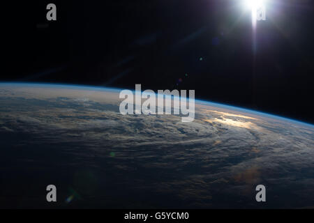 International Space Station Earth observation image captured by Expedition 47 members showing the sun reflecting - Stock Photo