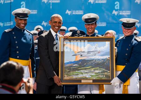 U.S President Barack Obama is presented with a gift from cadets Kristov George, Daniel Alotta and Mark Caldwell, - Stock Photo