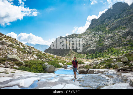 Young man hiking by the river Golo in the mountains, Nature Park of Corsica, Parc naturel régional de Corse, Corsica, France